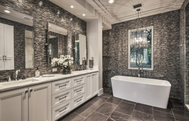 bathroom with white cabinets and 3 mirrors