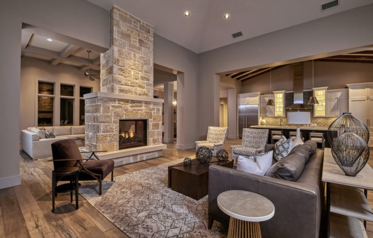 living room with a fireplace off the kitchen