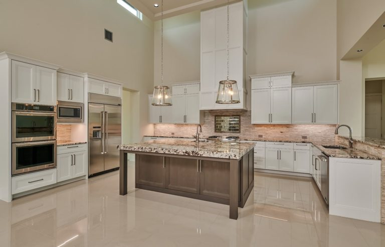 kitchen with white cabinets and neutral colors