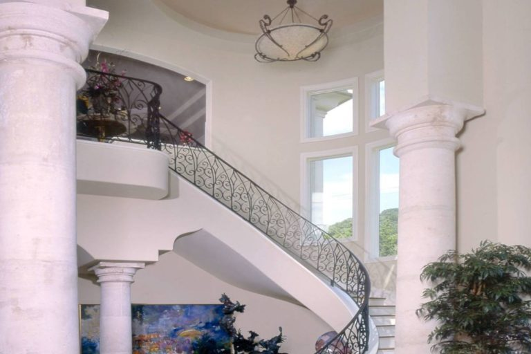 elegant staircase with dark iron siding