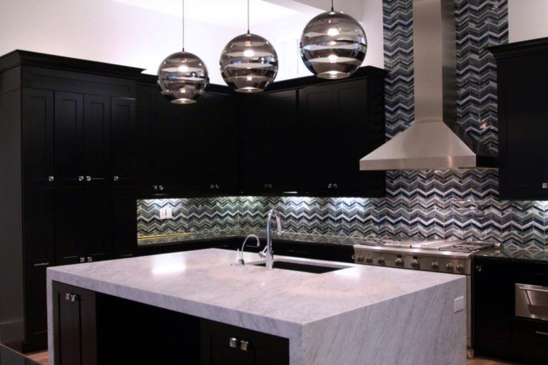 gray black and white kitchen with black cabinets