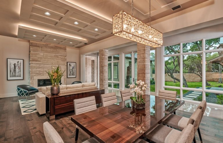 dinning and living room area with high ceilings